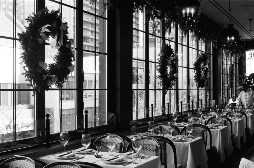 Restaurant decorated for the holidays and anticipating customers and online orders.